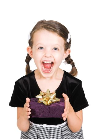 surprise face: little girl thrilled to receive gift, isolated over white