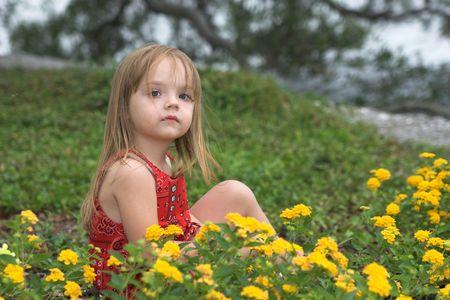 little girl sitting in flowers, portrait Stock Photo - 2196645