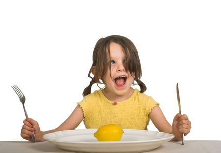 expressive little girl with single lemon on her plate, isolated