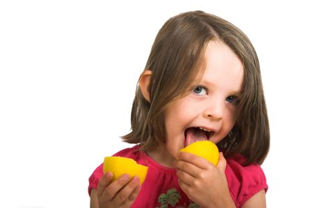 little girl sucking lemon, isolated over white