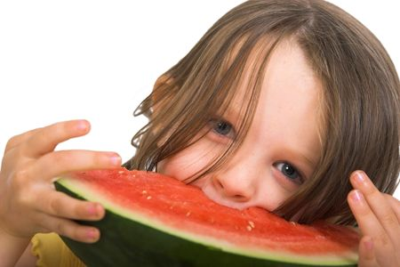 feasting: little girl feasting on watermelon, isolated over white