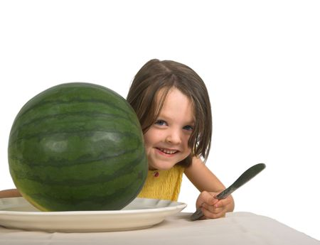 looking around: little girl looking around a large watermelon, isolated over white