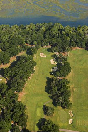 Aerial view of golf course on the coast  photo