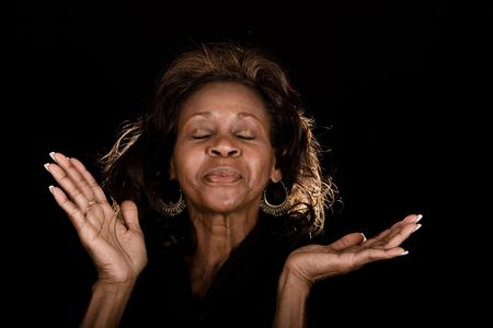 african american woman praising God Stock Photo