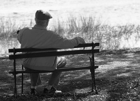 elderly gentleman on park bench, black and white