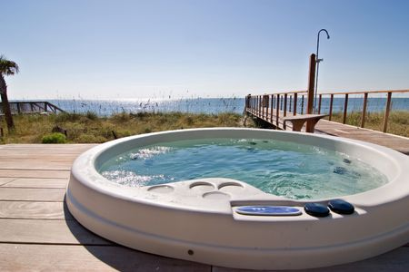 hot tub: hot tub next to the ocean Stock Photo