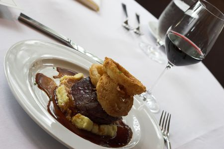 satisfying: sirloin with bed of potatoes and onion rings