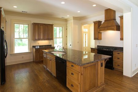 luxurious kitchen with dark wood and granite photo