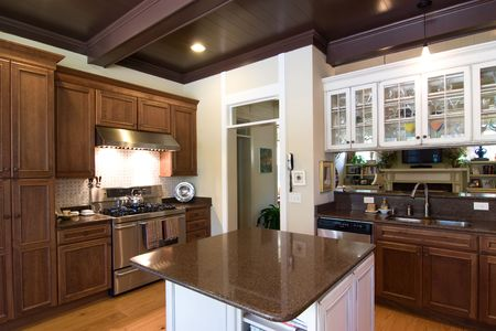 expensive granite: beautiful dark wood and granite kitchen with island