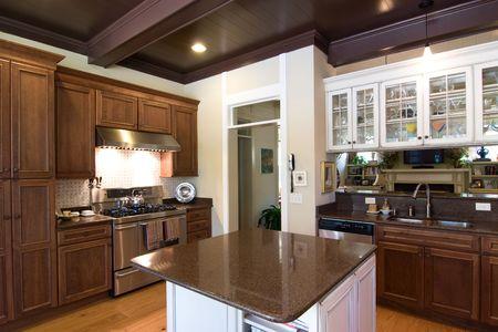 custom cabinet: beautiful dark wood and granite kitchen with island