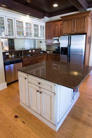 beautiful dark wood and granite kitchen with island