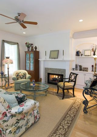 stone fireplace: expensive living area with lit fireplace