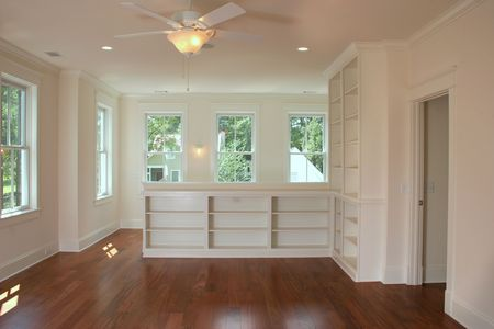 upstairs apartment or living area with built in shelves Stock Photo