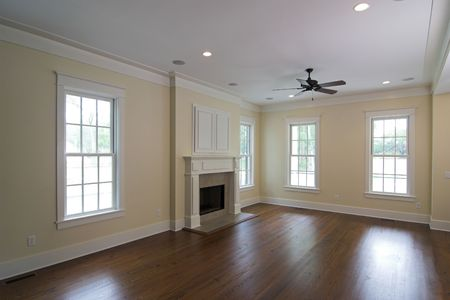 open, unfurnished living area with fireplace Stock Photo