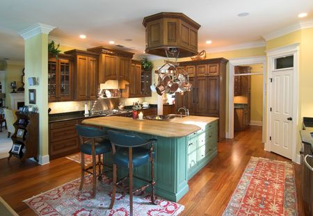 affluence: expensive custom kitchen with island