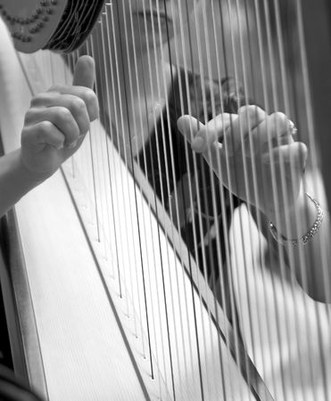 woman playing harp, black and white Stock Photo