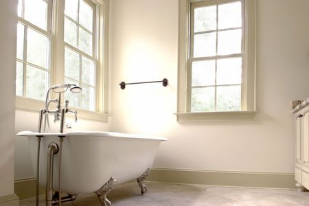 bathroom tile: simple white bathroom with clawfoot tub Stock Photo