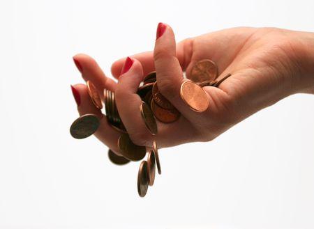 spendthrift: coins falling through fingers