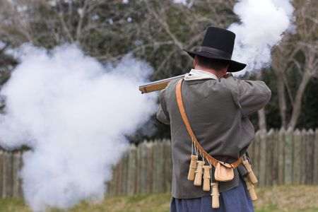 flint: man firing flint lock rifle
