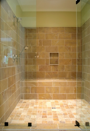bathroom tile: huge stone and glass shower Stock Photo