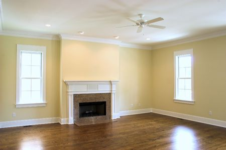 fan ceiling: unfurnished livingroom with fireplace Stock Photo
