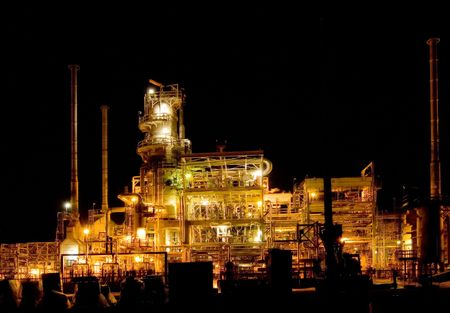 oil refinery lit up at night Stock Photo