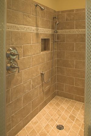 luxurious shower with stone walls and floor Foto de archivo
