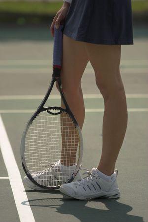 raquet: legs of female tennis player with raquet Stock Photo