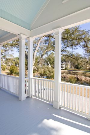 porch overlooking view of pond and neighborhood Stock Photo