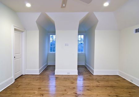 unfurnished upstairs bedroom with gable openings photo