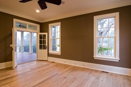 unfurnished: large unfurnished bedroom or diningroom with open doors to porch Stock Photo