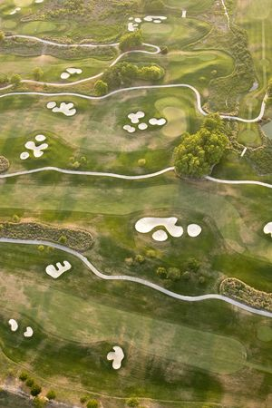 aerial view of golf course with several holes in view photo