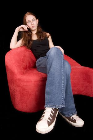 extreme angle: extreme wide angle shot of redhead seated, legs look long due to angle