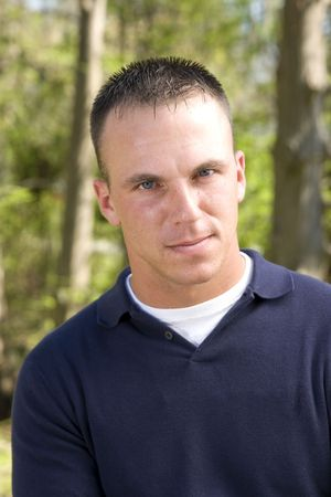 crewcut: young man outdoor portrait, waist up shot