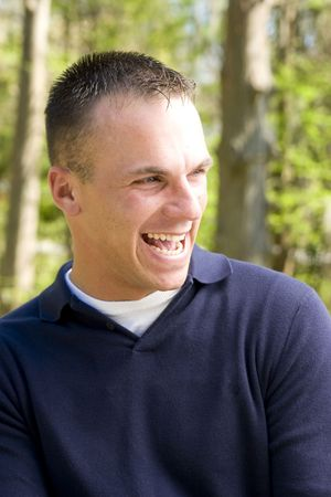 crewcut: young man in outdoor setting laughing Stock Photo