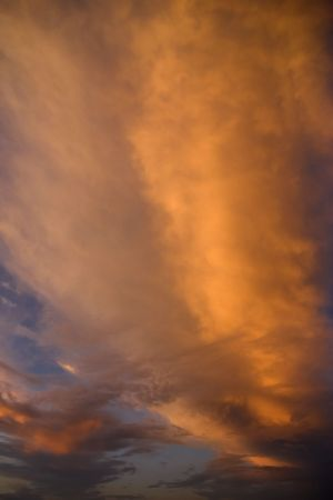 troposphere: dramatic cloudscape at sunset with orange and red clouds
