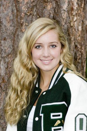pretty blond cheerleader in letter jacket