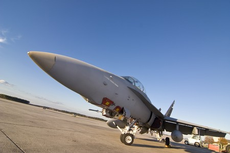 f18: f-18 fighter jet on the ground, wide angle view