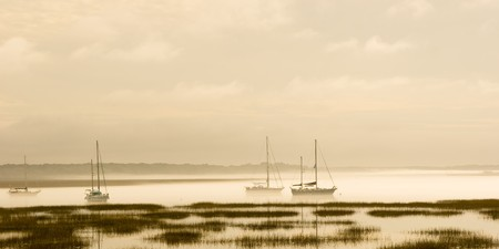 sultry: fog on sultry day over coastal water Stock Photo