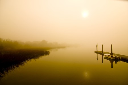 sultry: fog over water on hot sultry day