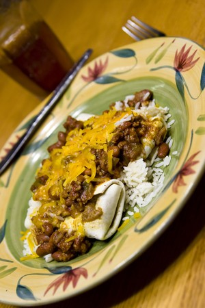 smothered: burritos smothered with chili and cheese over rice