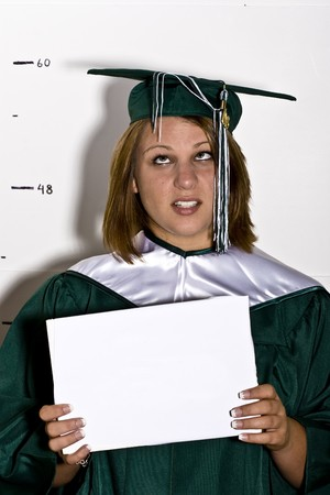 senior graduation picture, purposefully done poorly, student holding blank sign and standing in front of height chard Stock Photo - 4248119