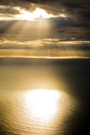 Morning light streaming through dark clouds on the the Atlantic Ocean, aerial shot Stock fotó