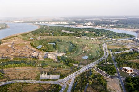 aerial view of new development and golf course on island photo