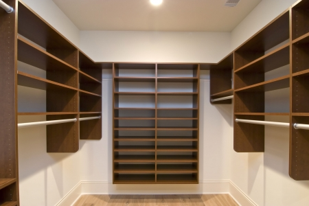 large walk in closet with modular shelves Stock fotó
