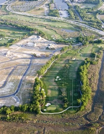 aerial view of new development with golf course photo