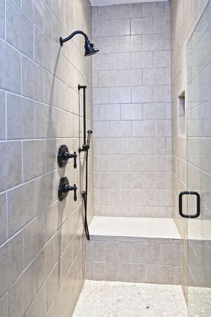 luxury shower with bench and pebble floor photo