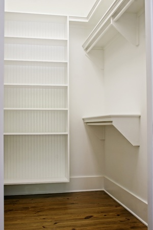 large white empty walk-in closet with shelves Stock Photo - 9071274
