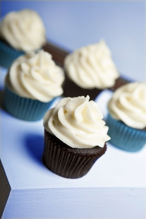 cupcakes on stand with blue color scheme photo
