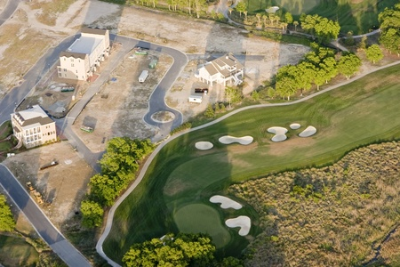 new residential development next to golf course, aerial